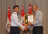 MG Ng receiving his certificate of promotion from Dr Ng.