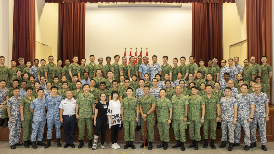 A group photo of all the promotees with COL Koh, past and present commanders, trainers and staff of SAFVC.