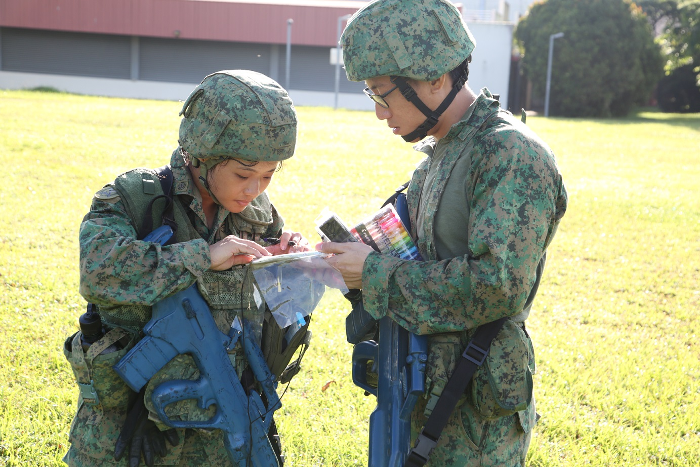 MSG Amanda Thea Tan (left) during the navigation exercise.