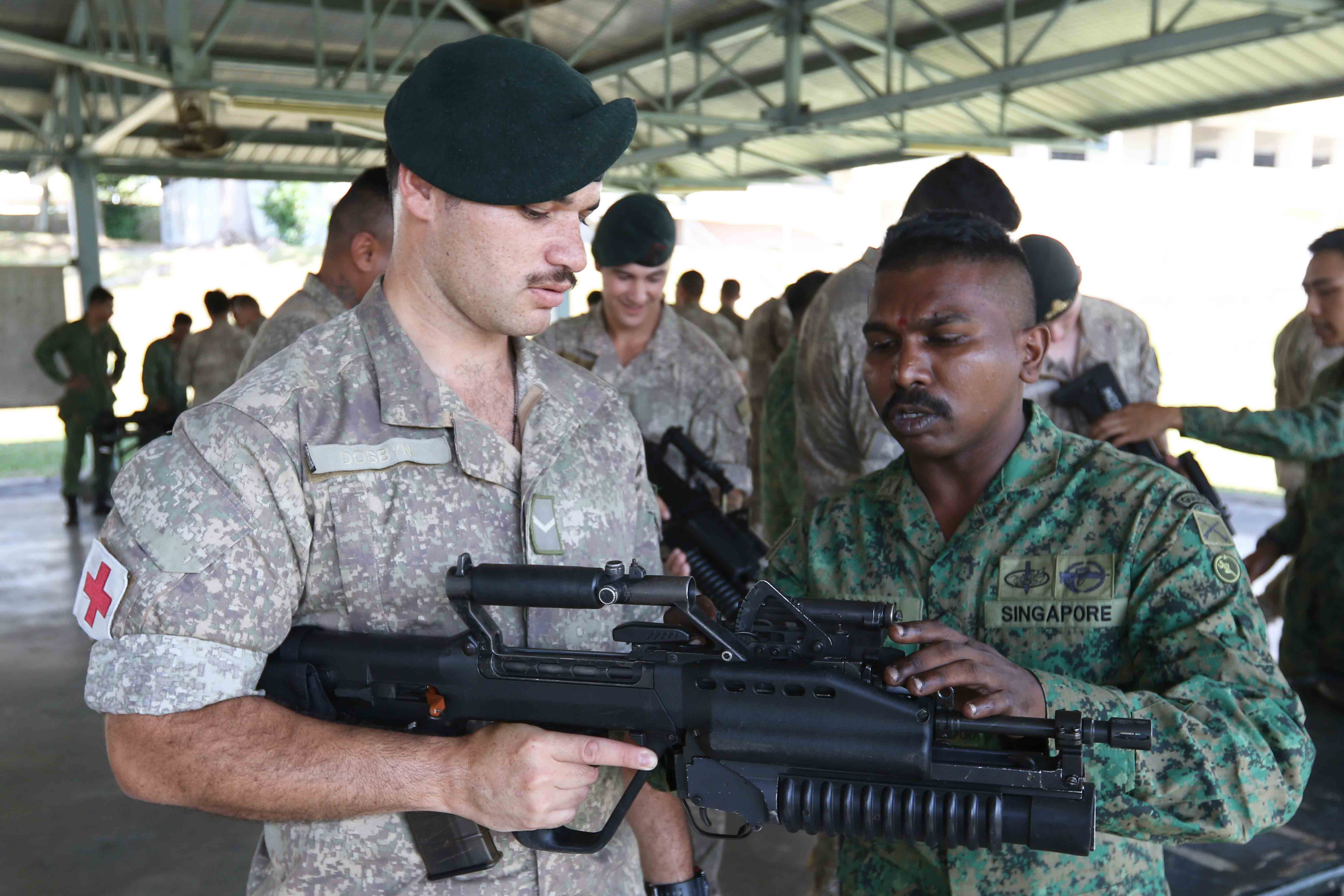 Our soldier sharing with fellow NZDF soldiers on our SAR 21 M203 Grenade Launcher capabilities and specifications.