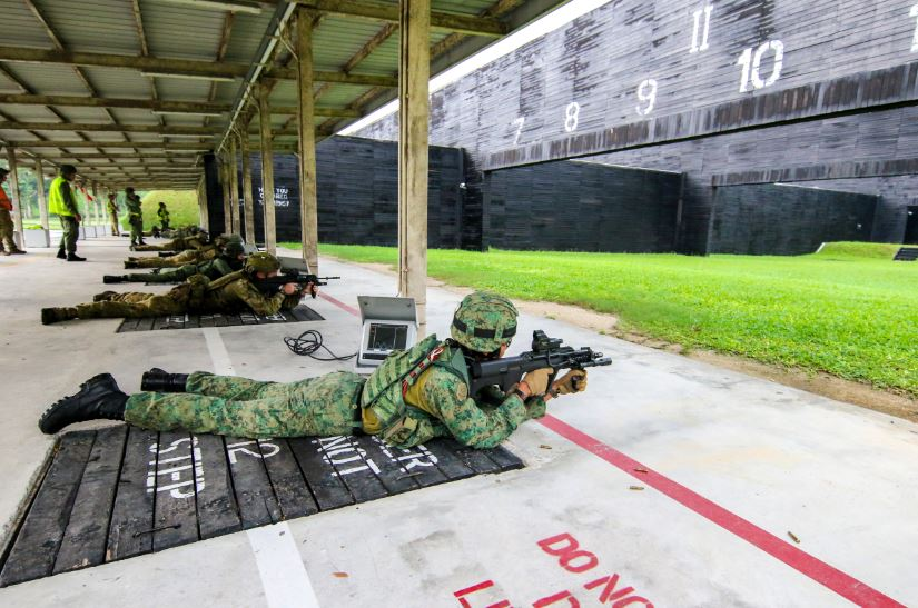 Our Army's soldier engaging a figure 12 target in prone position from a 100m firing point with a Singapore Assault Rifle - 21st Century Modular Mounting System.