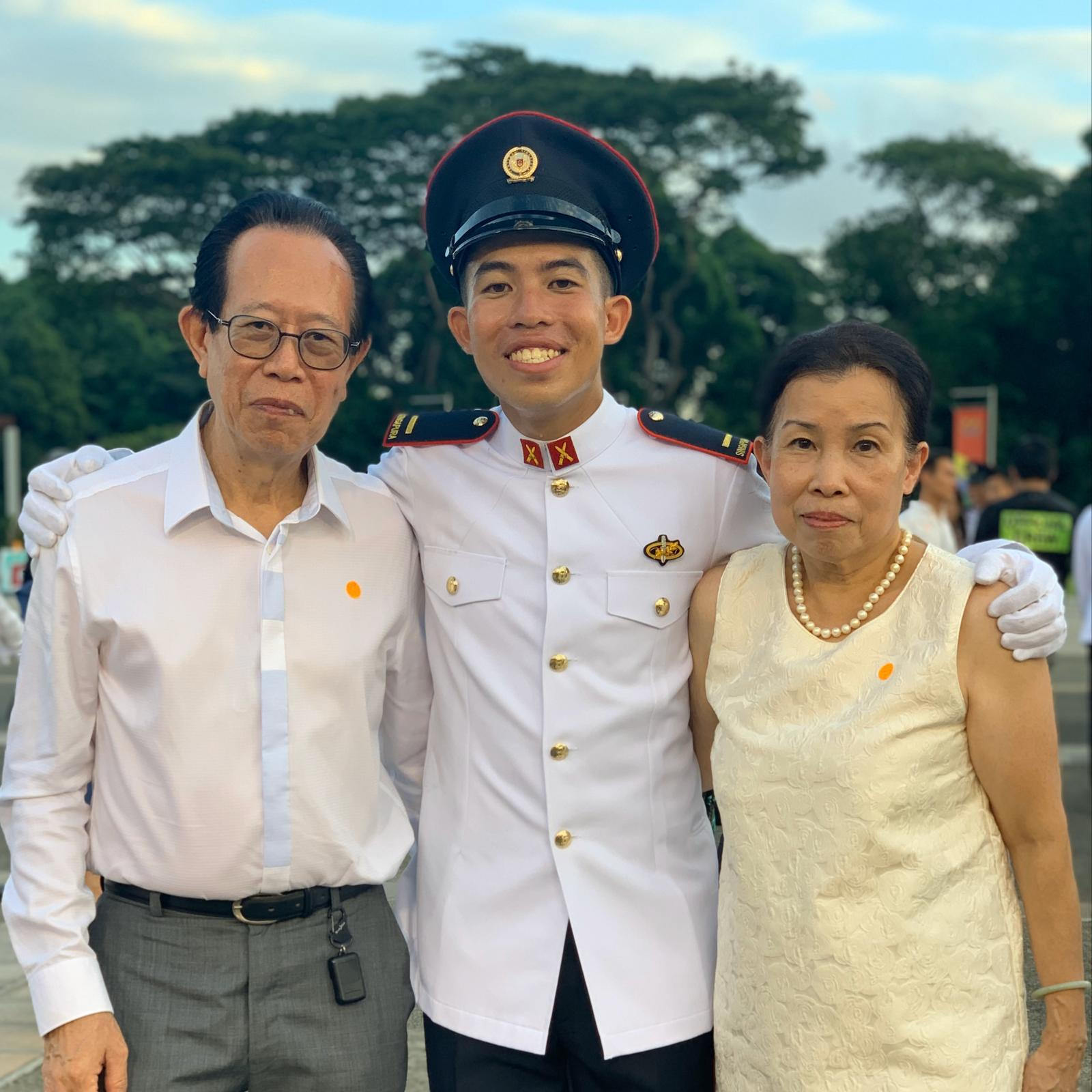 2LT Sean Pang (centre) with his parents during the Officer Cadet Commissioning Parade.