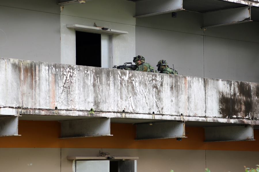 Our troops storming a building.