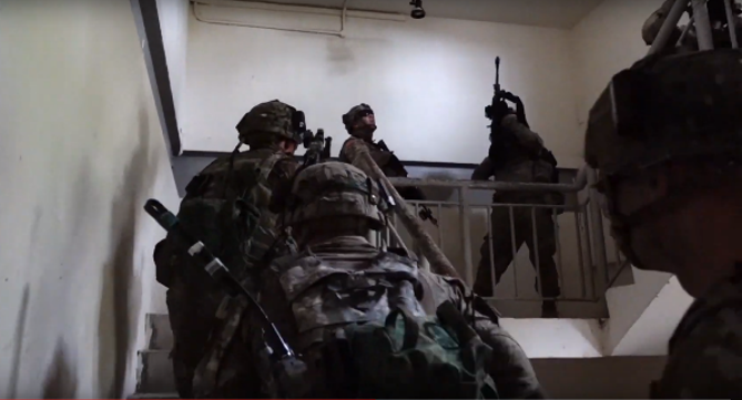 US troops clearing the building.