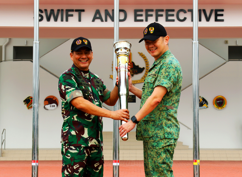 Lieutenant General Tatang Sulaiman handing over the XSI torch to Brigadier-General (BG) Kenneth Liow.