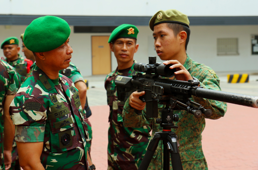One of our soldiers showcasing the M110 Semi-Automatic Sniper Rifle to an Indonesian soldier.