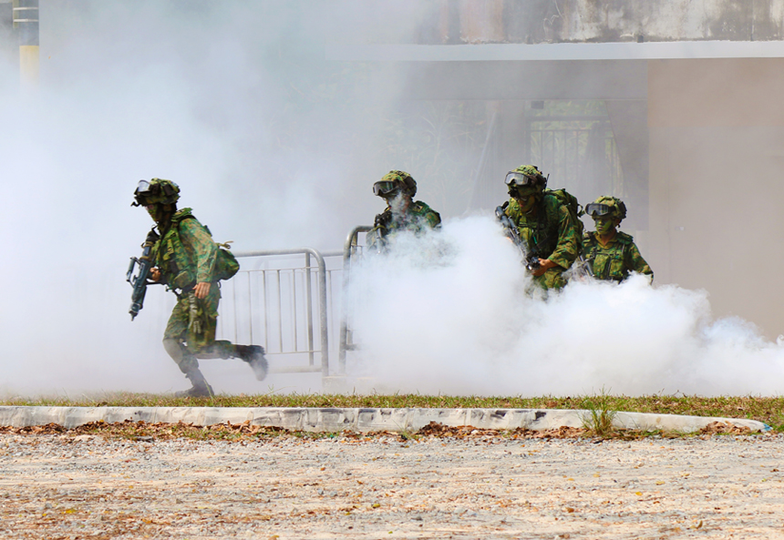 Our troops running under the cover of tactical smoke during the final exercise.