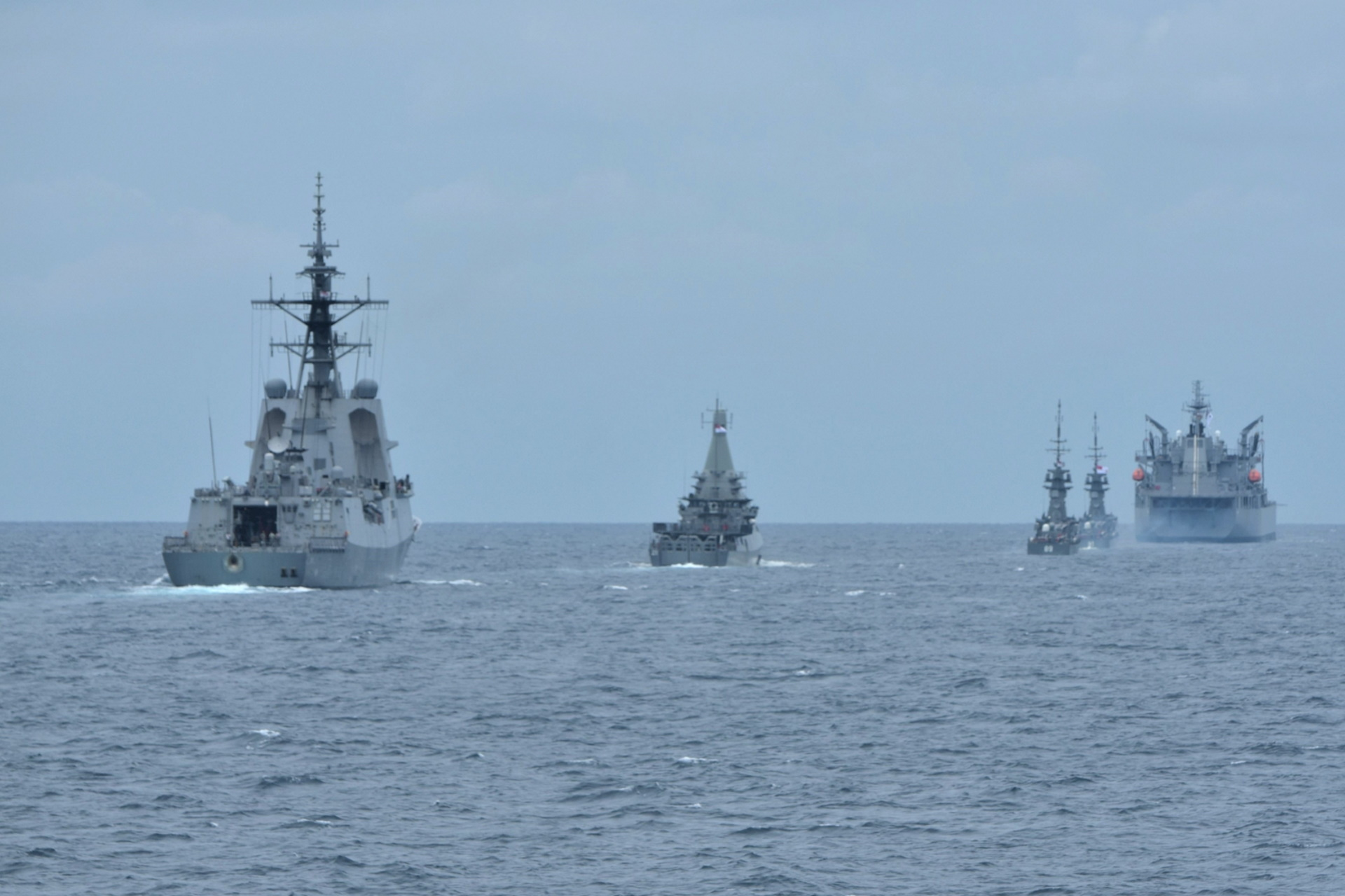 The Republic of Singapore Navy (RSN)'s littoral mission vessel RSS Dauntless (second from left) and missile corvettes RSS Valour (middle), RSS Valiant (second from right) conducting a manoeuvring exercise with the Royal Australian Navy (RAN)'s destroyer HMAS Hobart (left) and oiler HMAS Sirius (right) during Exercise Singaroo.