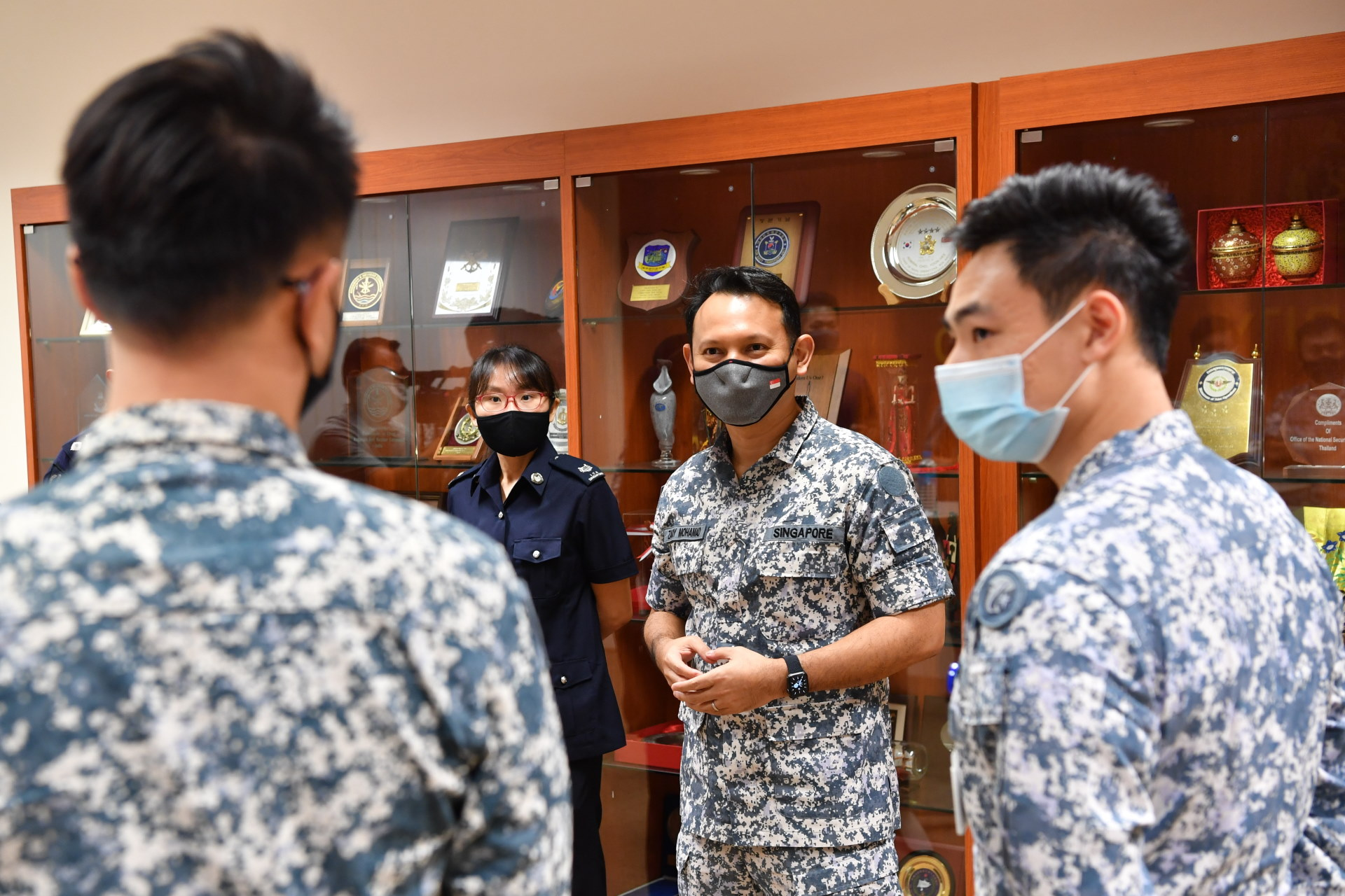 Mr Zaqy (second from right) interacting with personnel from MSTF and the Singapore Maritime Crisis Centre.