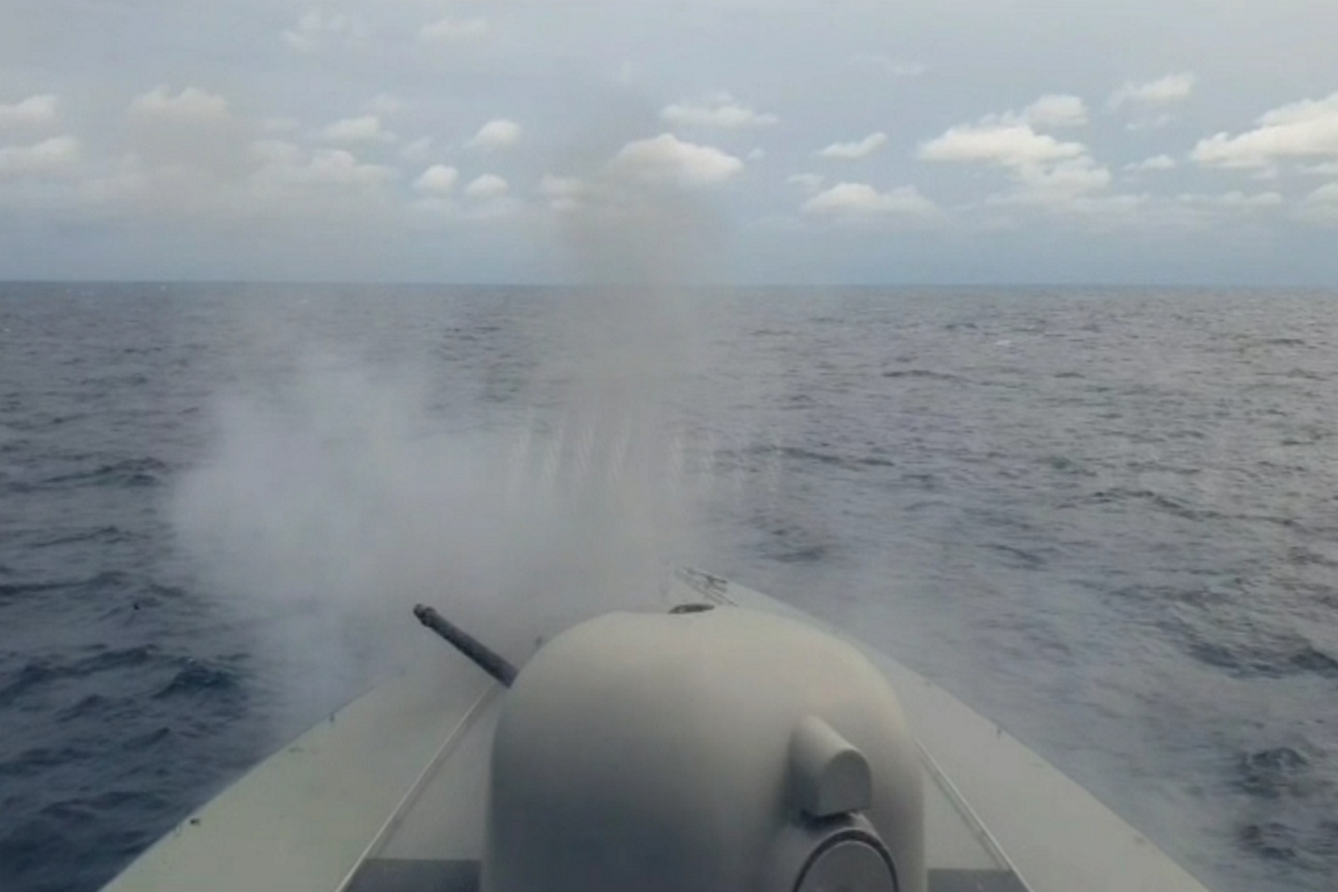 RSS Dauntless conducting a gunnery firing during the exercise.