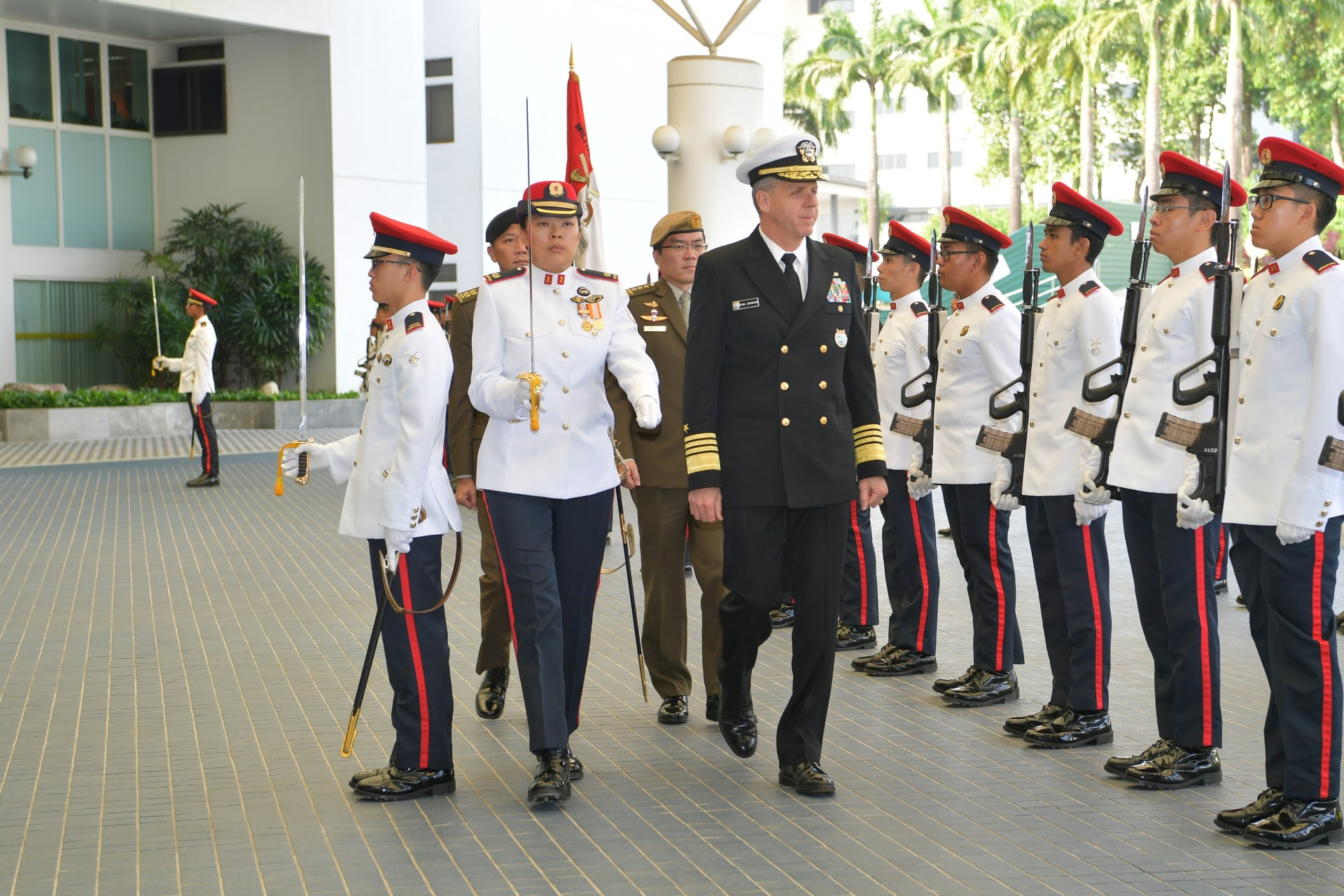 ADM Davidson reviewing a Guard of Honour at MINDEF.
