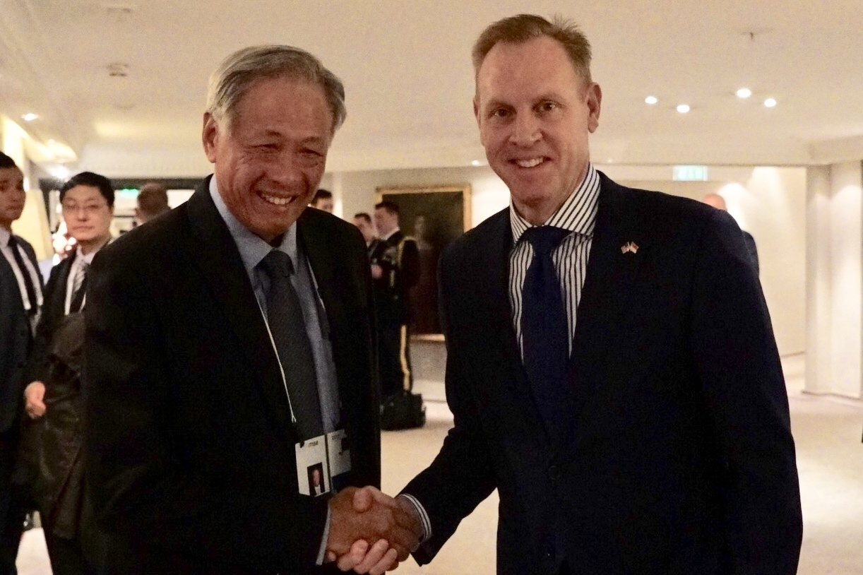 Minister for Defence Dr Ng Eng Hen (left) with United States Acting Secretary of Defense Patrick Shanahan (right) on the sidelines of the 55th Munich Security Conference.