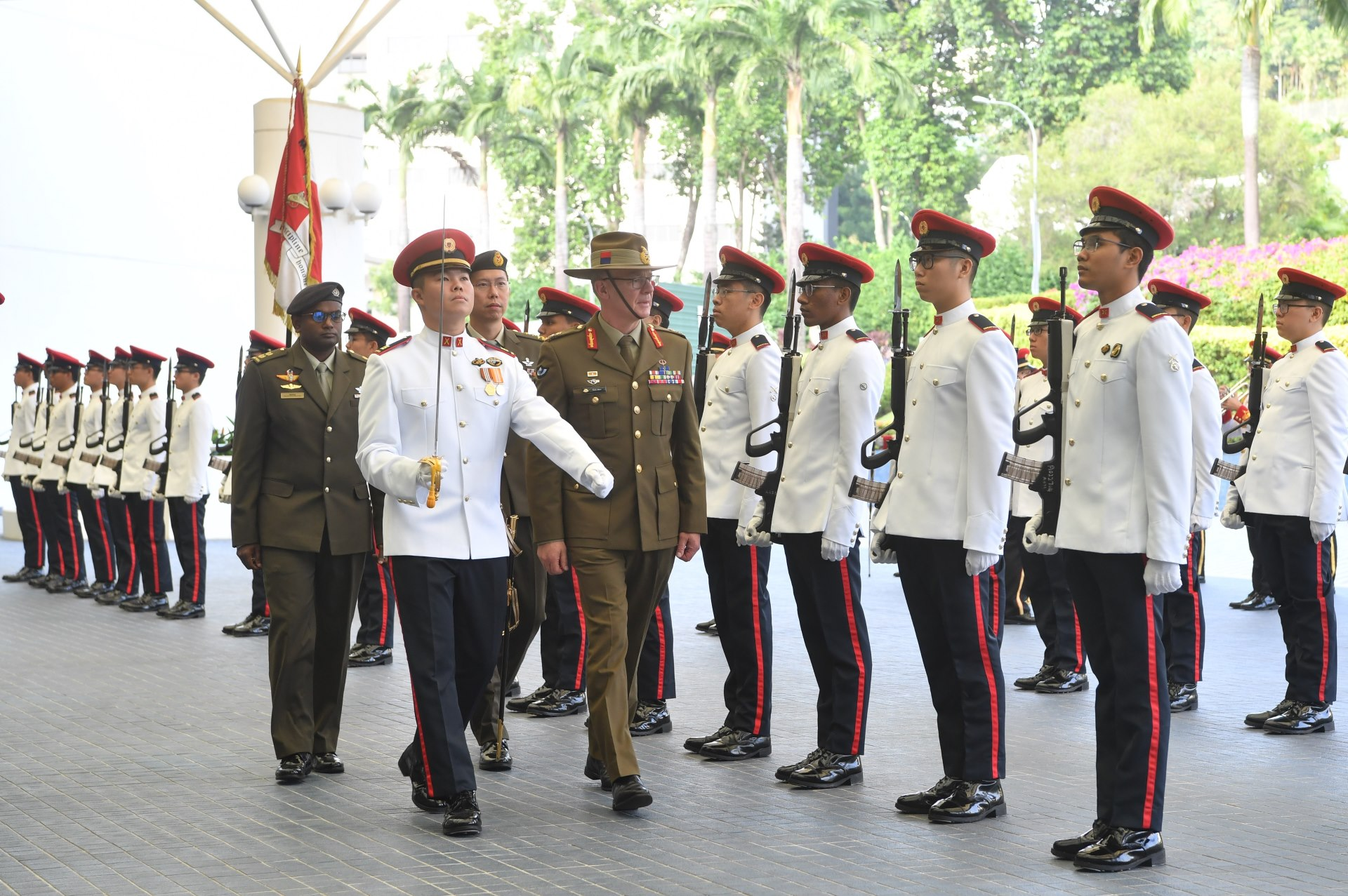 LTGEN Burr reviewing a Guard of Honour at MINDEF earlier today.