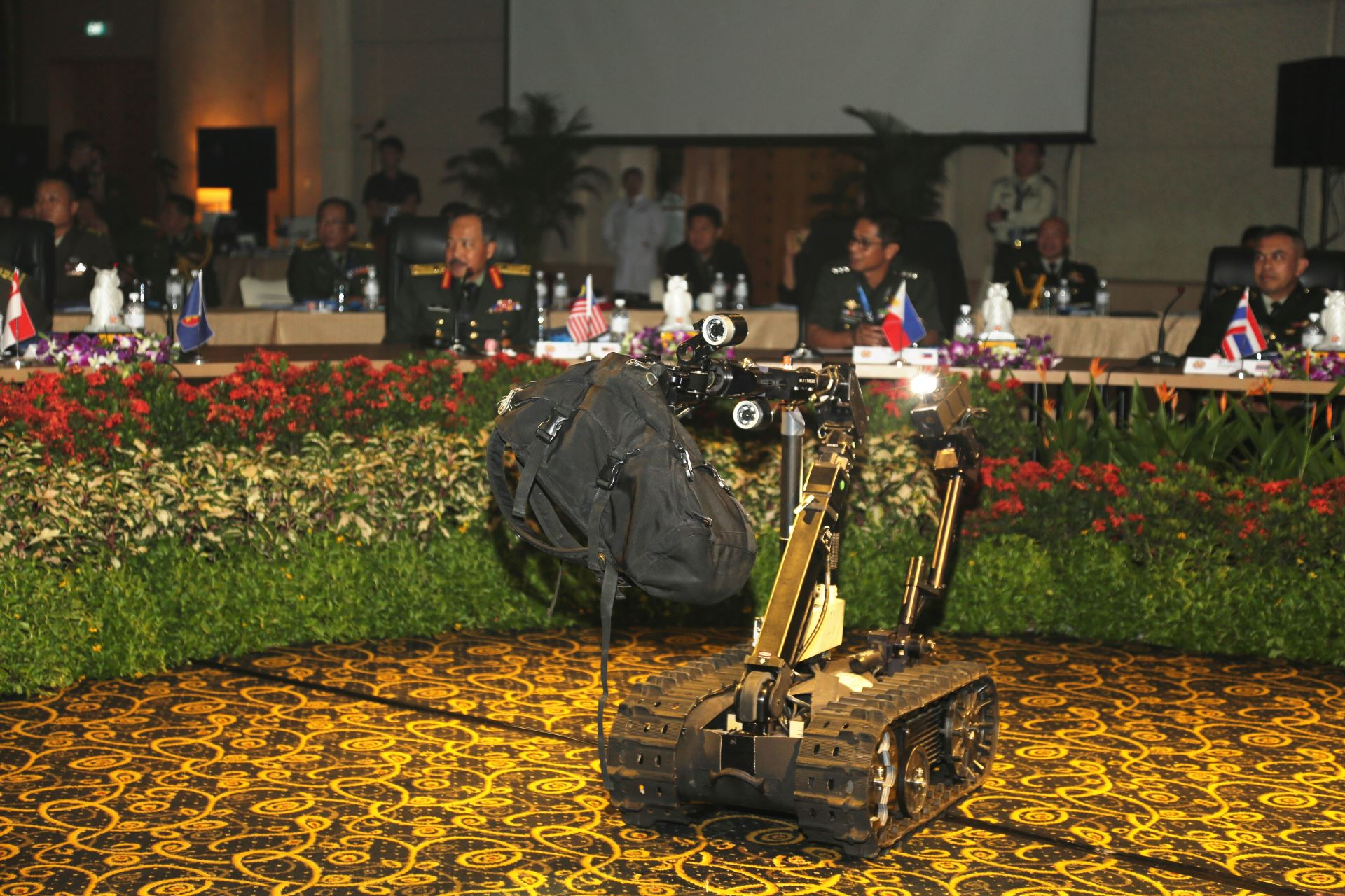 A Talon Unmanned Ground Vehicle removes a suspicious bag for containment in a demonstration by the Singapore Army's Chemical, Biological, Radiological and Explosives (CBRE) Defence Group.