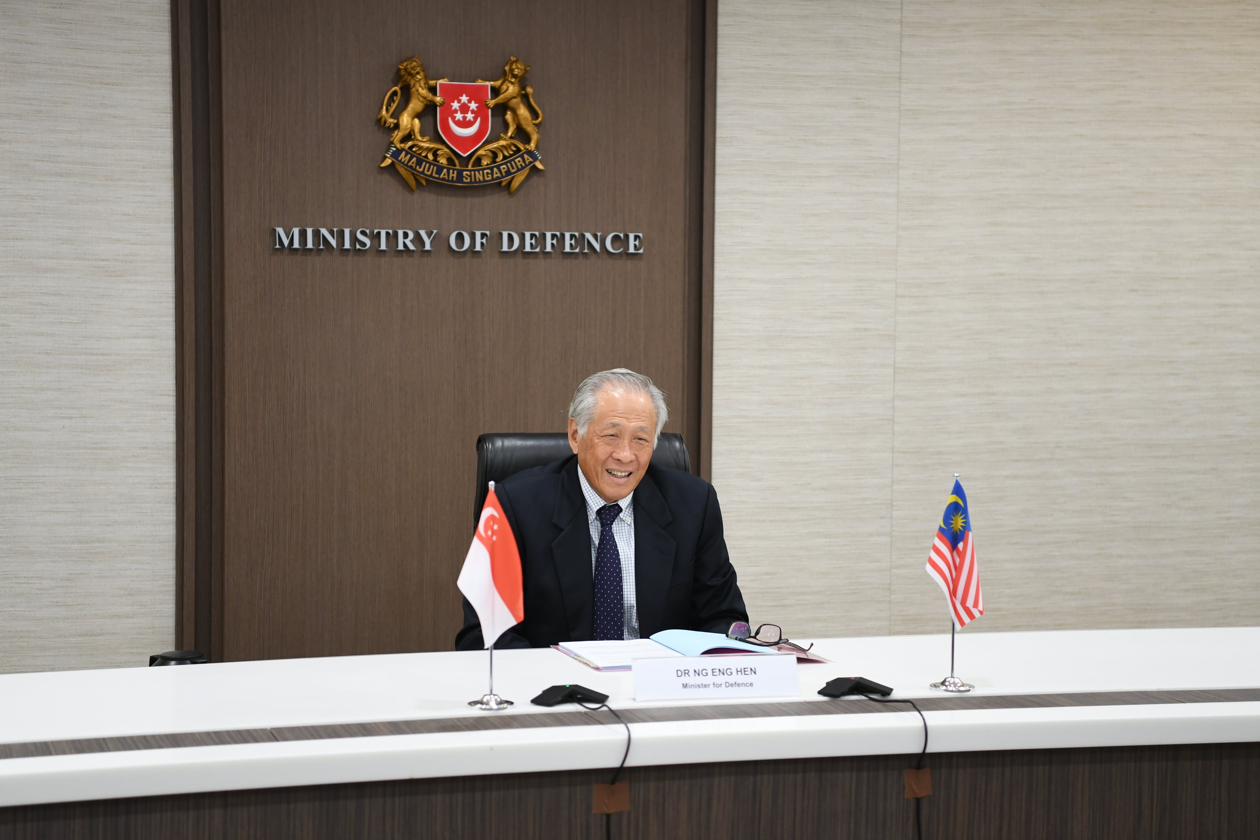 Minister for Defence Dr Ng Eng Hen speaking with Malaysian Senior Minister (Security Cluster) and Minister of Defence Ismail Sabri Yaakob during a bilateral video conference.