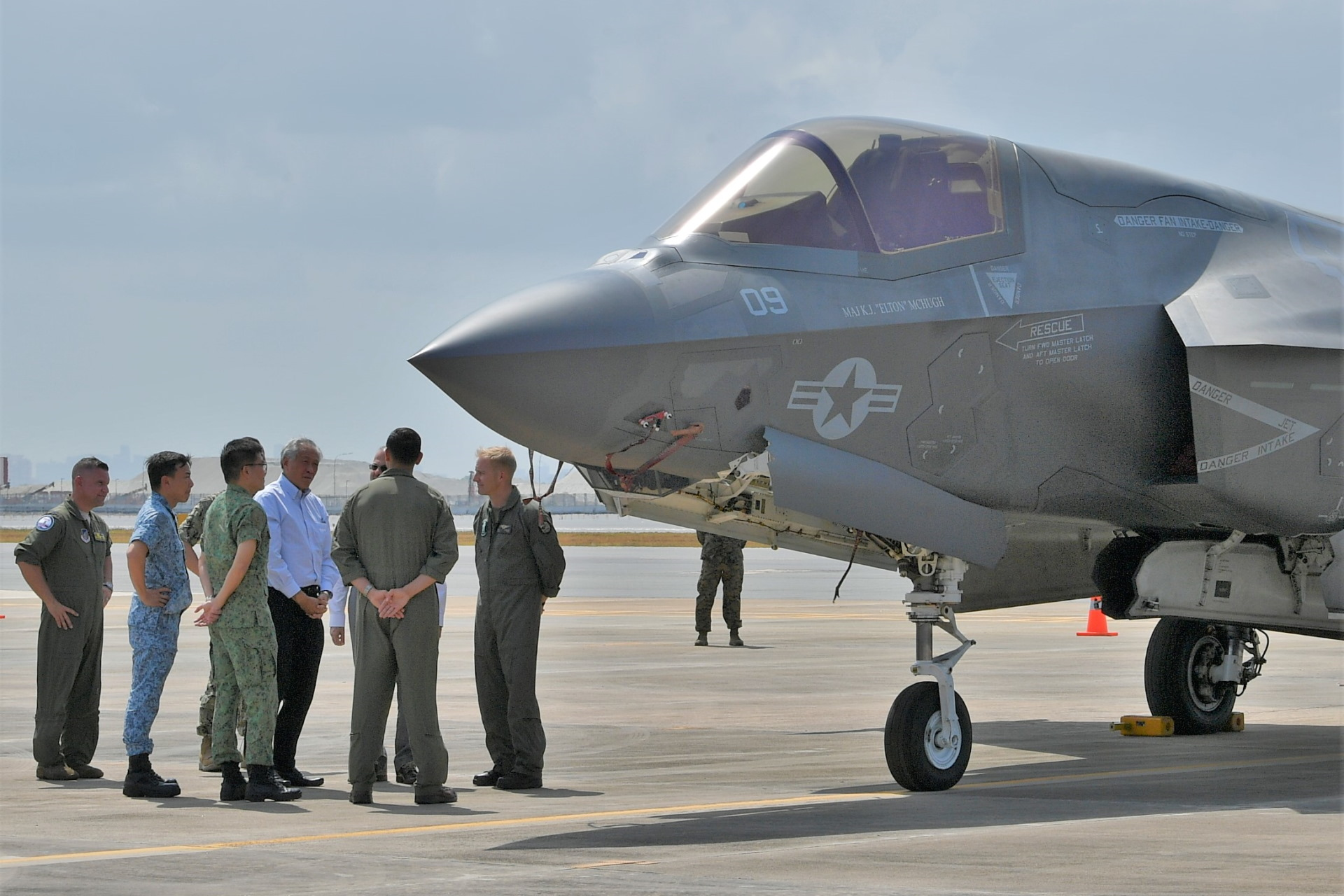 Dr Ng (middle, in white) receiving a brief on the United States' Marine Corps F-35B Joint Strike Fighter.
