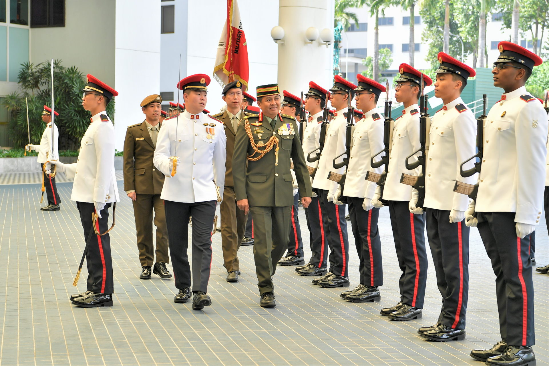 BG Dato Seri Pahlawan Awang Khairul Hamed reviewing a Guard of Honour at MINDEF prior to the award investiture.