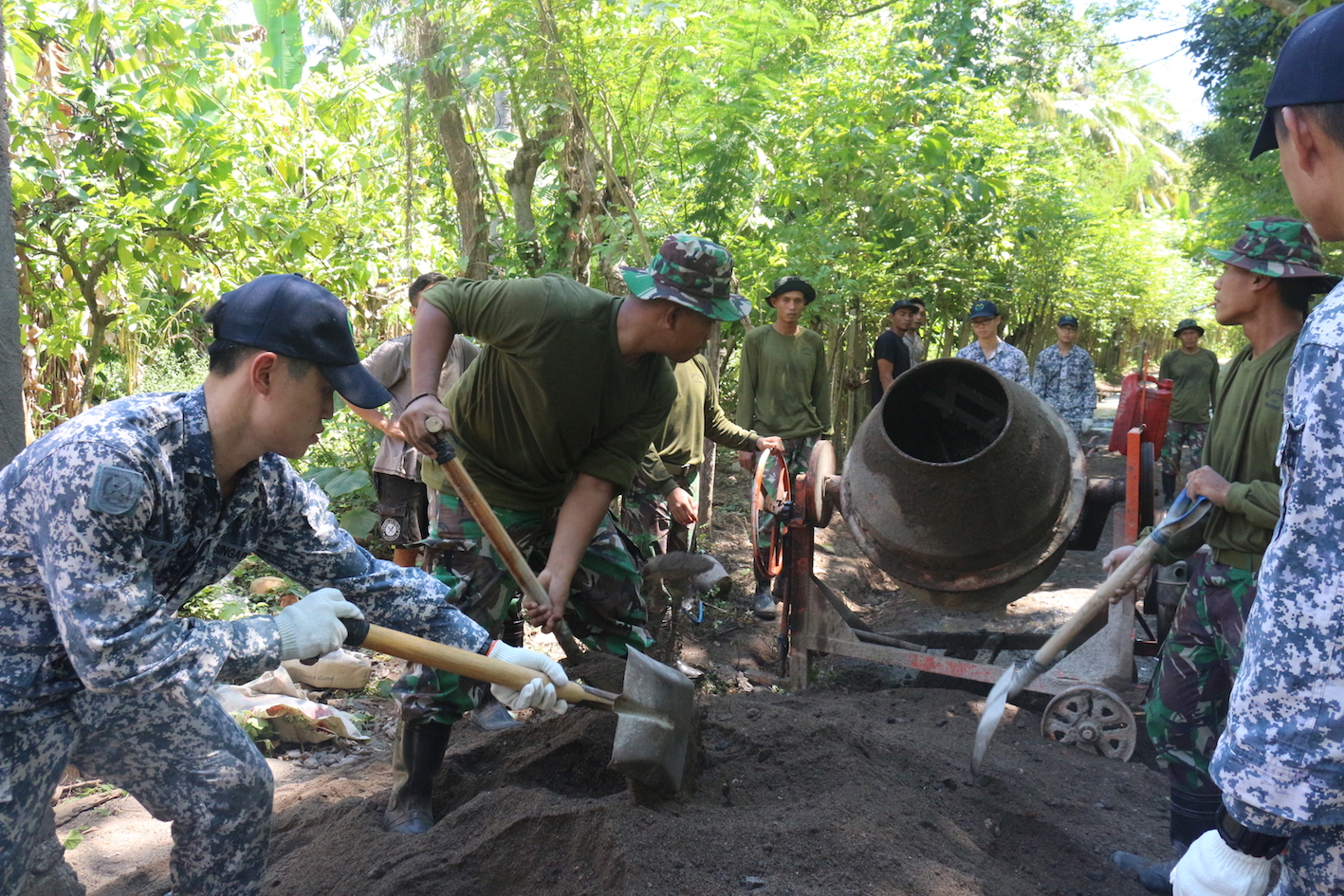 RSN personnel working with the TNI AL in the multinational Engineering Civic Action Programme.