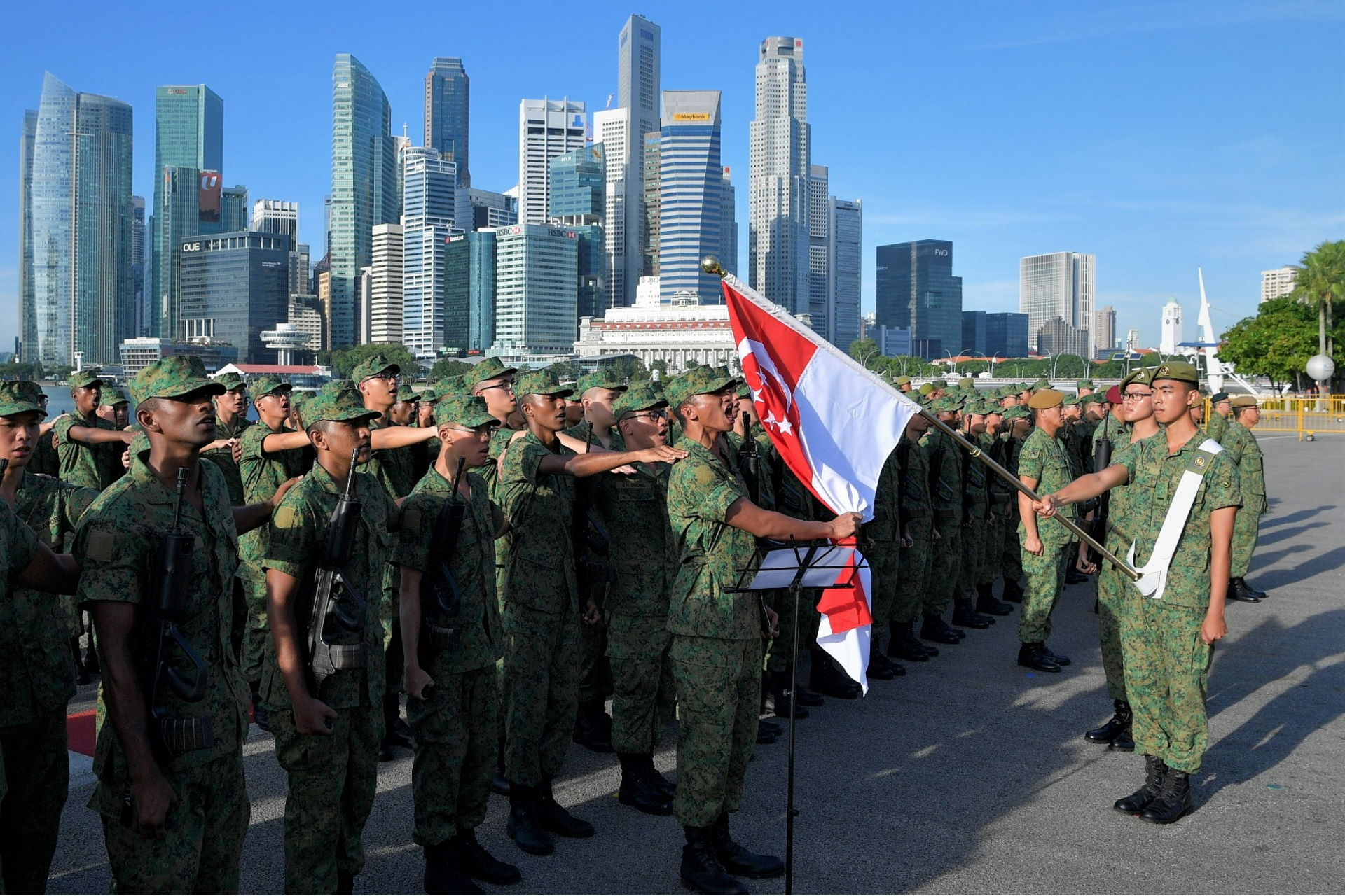 Recruits from the Basic Military Training Centre (BMTC) reciting the Weapon Creed at the Total Defence Day Commemoration Event at The Float @ Marina Bay this morning.