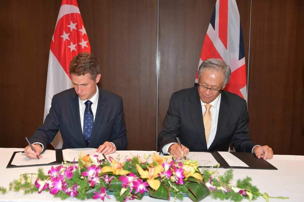 Minister for Defence Dr Ng Eng Hen and United Kingdom Secretary of State for Defence Gavin Williamson signing the Defence Cooperation Memorandum of Understanding (DCMOU) on the sidelines of the 17th Shangri-La Dialogue (SLD).