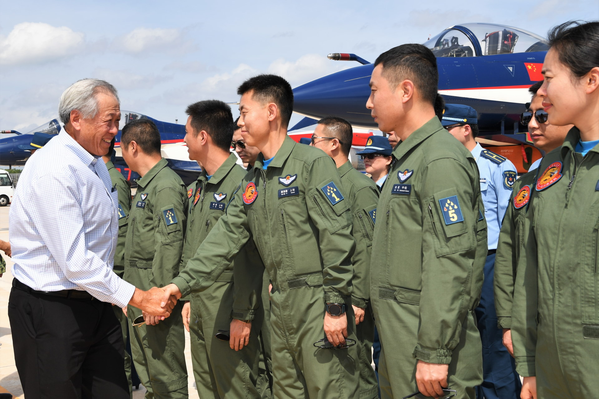 Dr Ng visiting the aircrew from the People's Liberation Army Air Force Ba Yi aerobatics team.