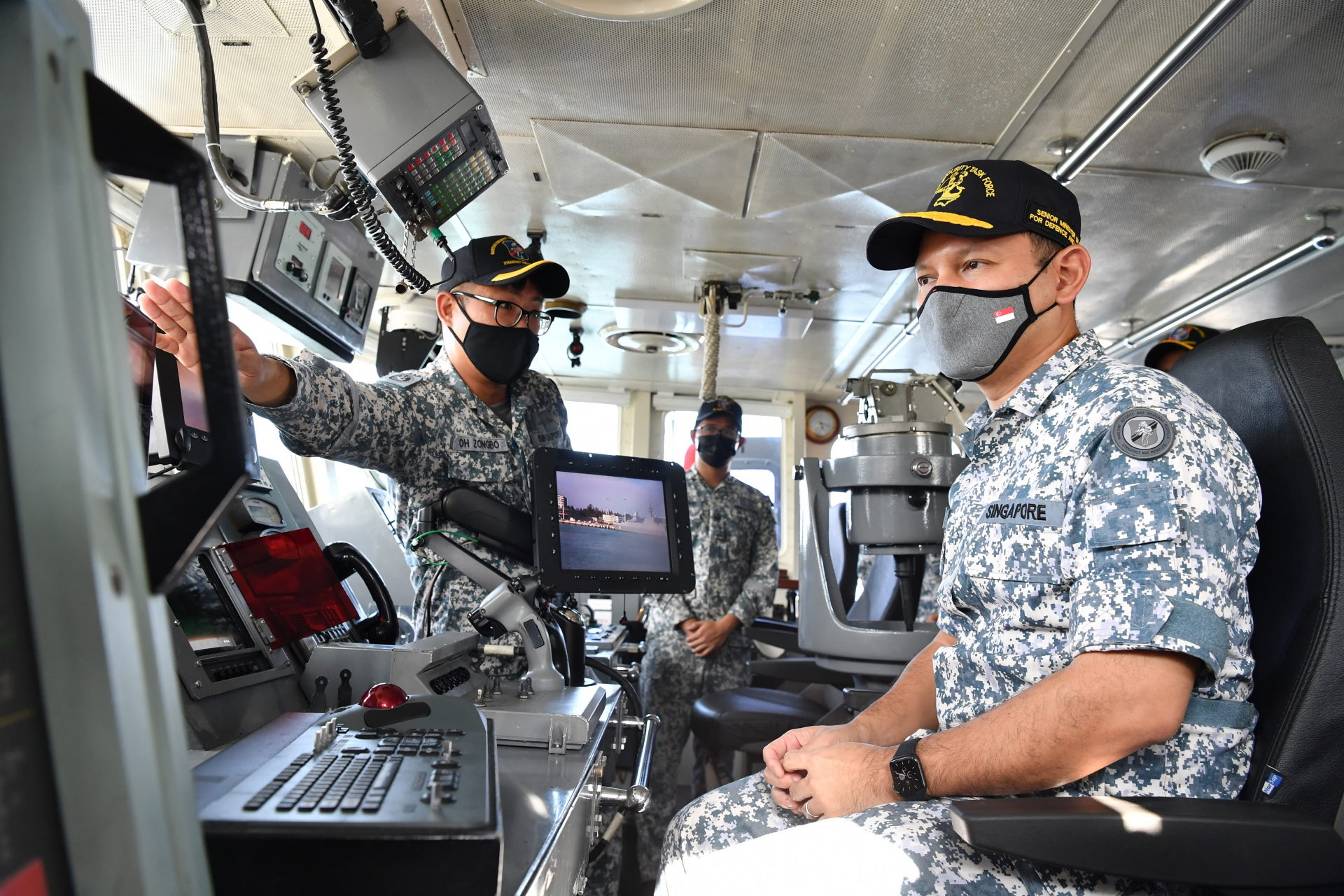 Mr Zaqy (right) being briefed on the capabilities of the Maritime Security and Response Vessel.