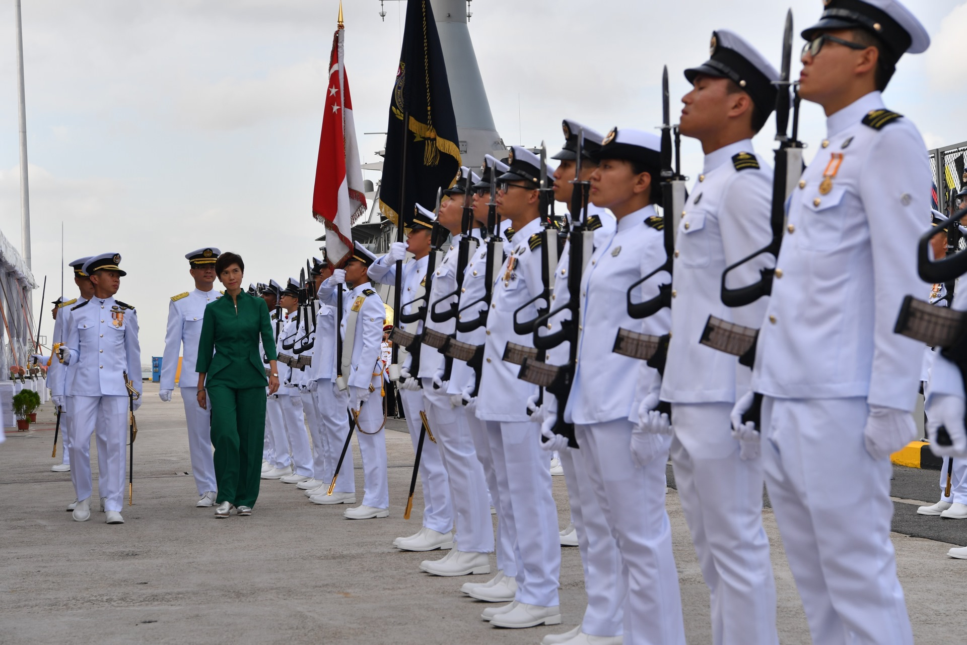 Minister for Manpower and Second Minister for Home Affairs Josephine Teo reviewing the Guard of Honour at the commissioning ceremony of the final three LMVs, RSS Fortitude, RSS Dauntless and RSS Fearless.