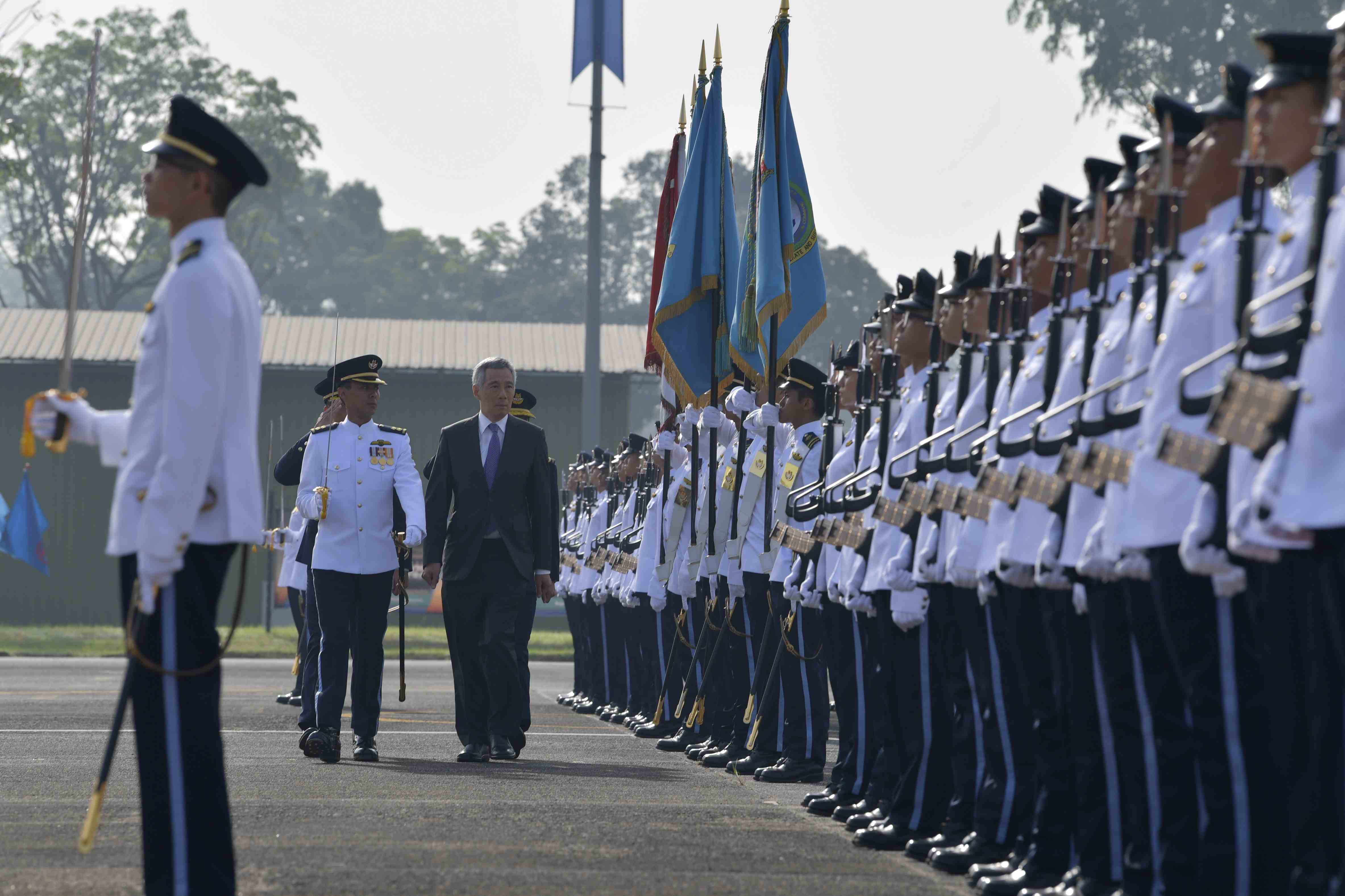 Prime Minister (PM) Lee Hsien Loong reviewing the Guard of Honour at the RSAF50 Parade this morning at Tengah Air Base.