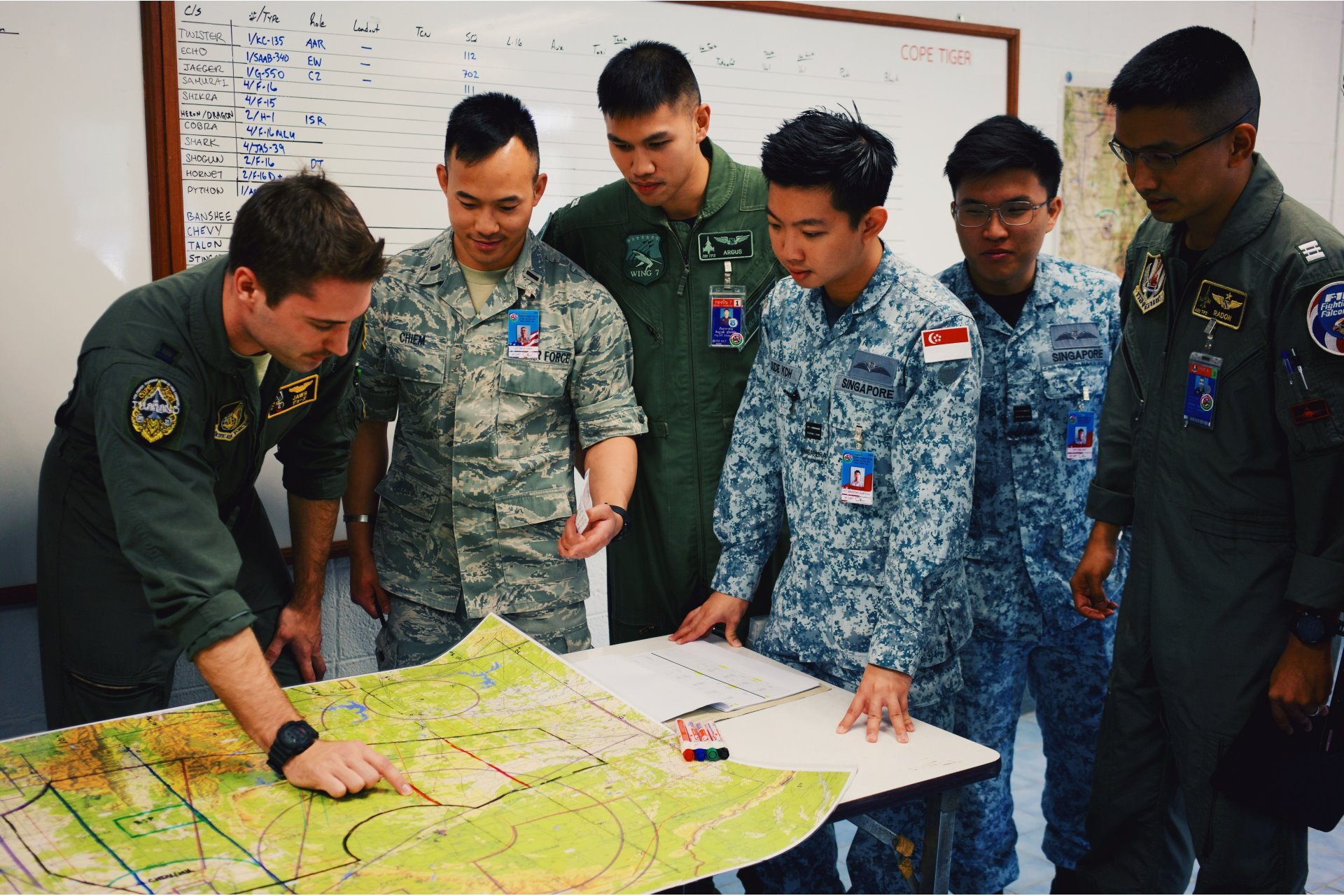 Exercise participants from the three Air Forces planning for a flight mission at Exercise Cope Tiger 2019.