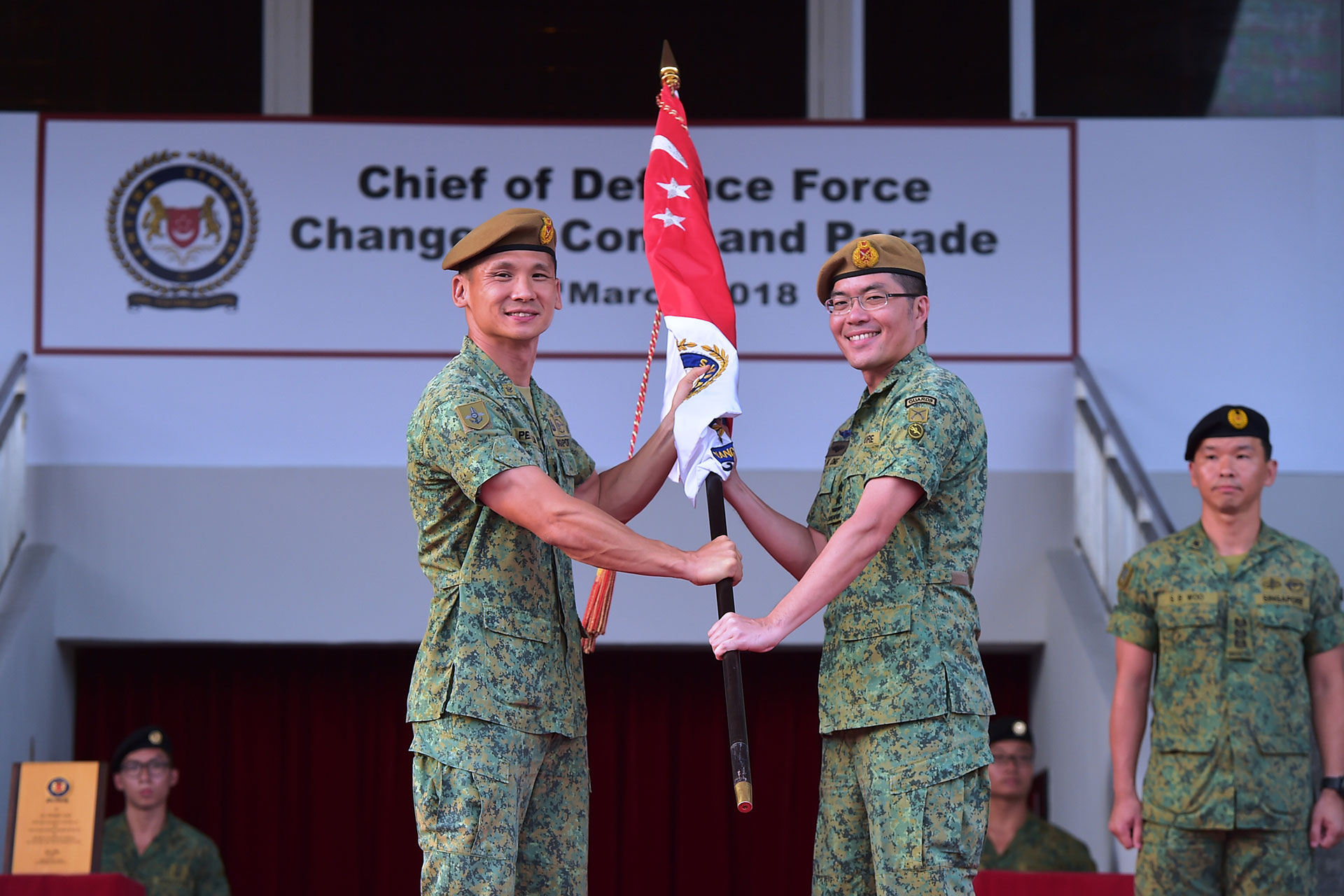 Outgoing Chief of Defence Force Lieutenant-General (LG) Perry Lim (left) handing over the command symbol to incoming Chief of Defence Force Major-General (MG) Melvyn Ong (right) at the Change of Command Parade held at SAFTI Military Institute.
