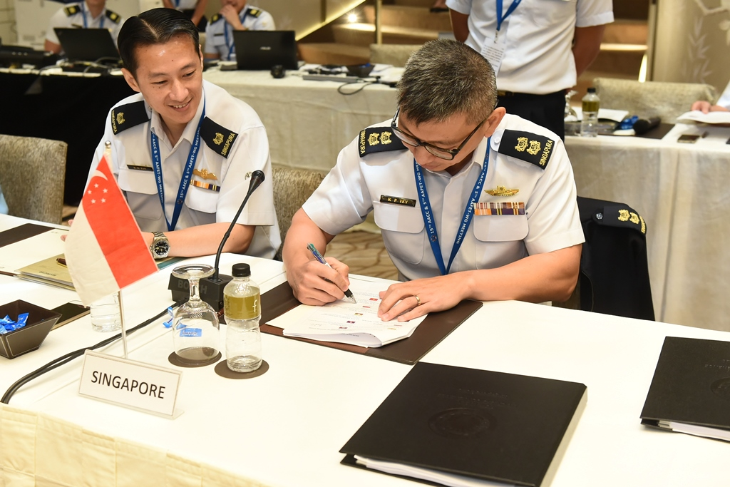 Working level representatives from the Republic of Singapore Air Force signing the enhanced ASEAN Air Forces Standard Operating Procedure.