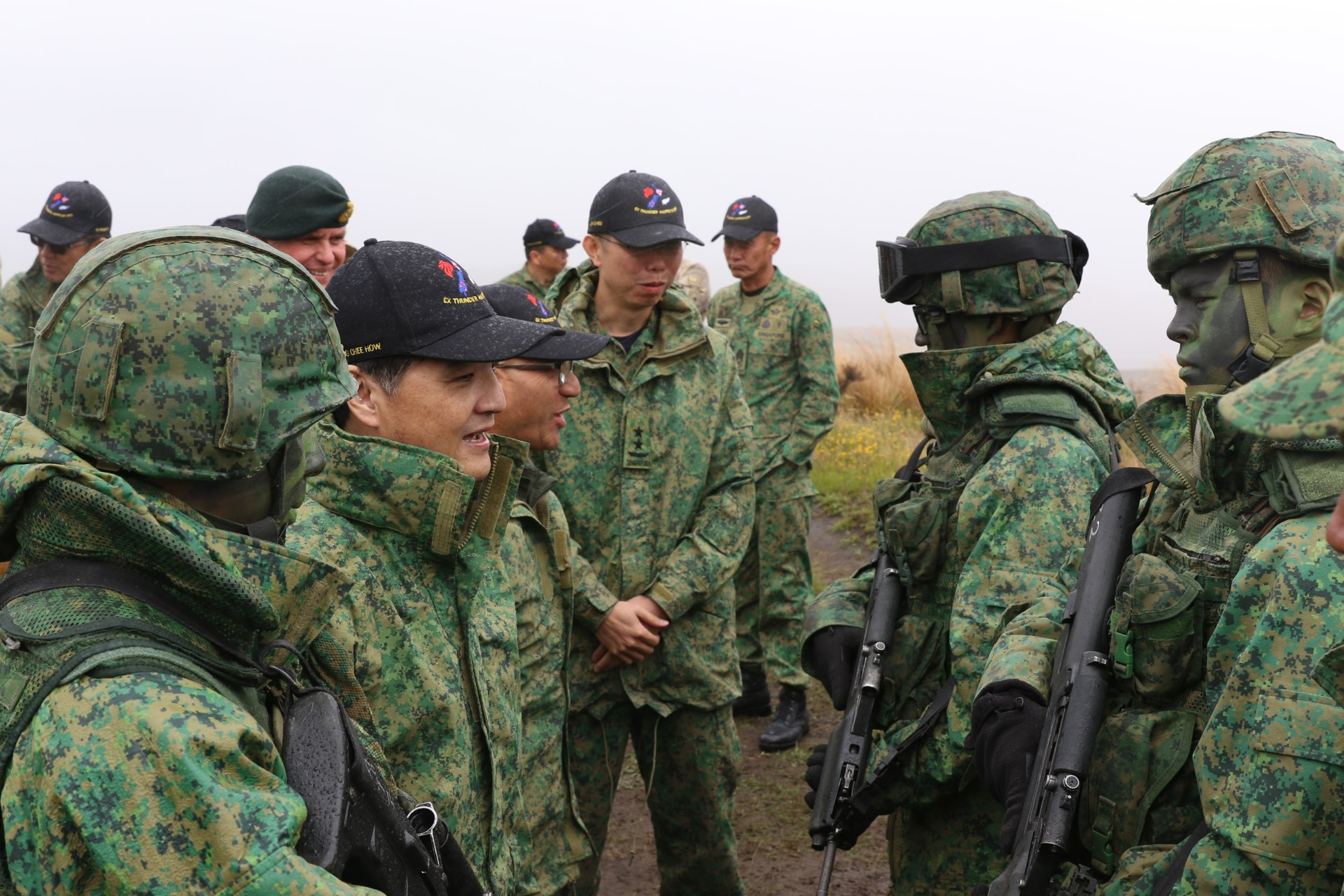 senior minister of state for defence mr heng chee how second from left and