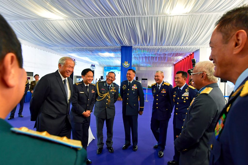 Minister for Defence Dr Ng Eng Hen (second from left) interacting with the nine ASEAN Air Chiefs and the Deputy Chief of the Air Force Department, Lao People's Army, at the RSAF50 Parade.