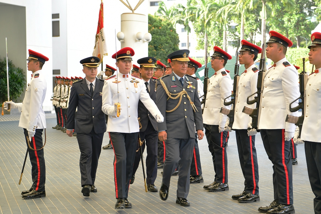 Commander of the Royal Brunei Air Force (RBAirF), Brigadier General (BG) (U) Dato Seri Pahlawan Haji Hamzah bin Haji Sahat reviewing a Guard of Honour at the Ministry of Defence (MINDEF) this morning.