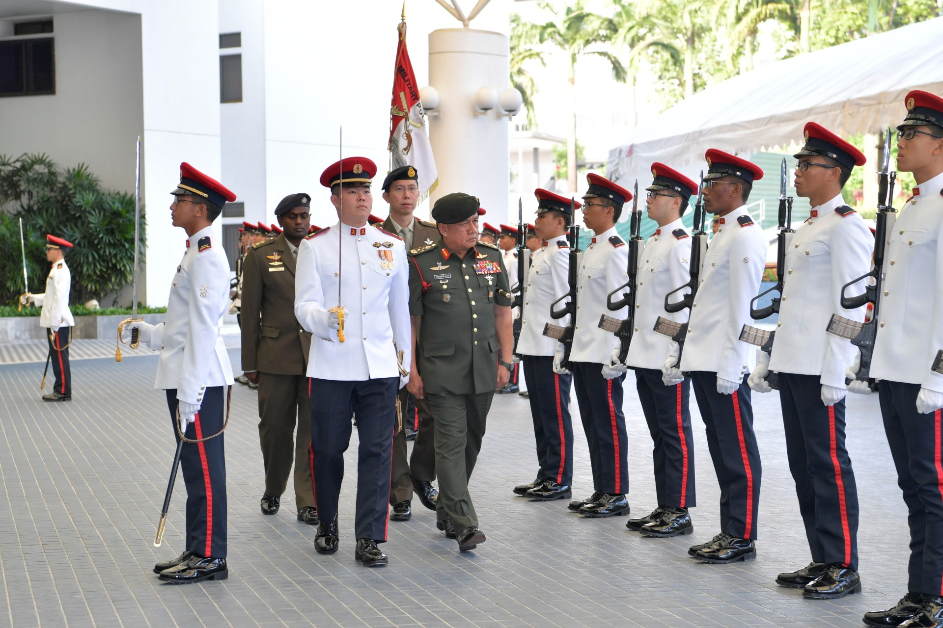 GEN Hasbullah reviewing a Guard of Honour at MINDEF earlier today.