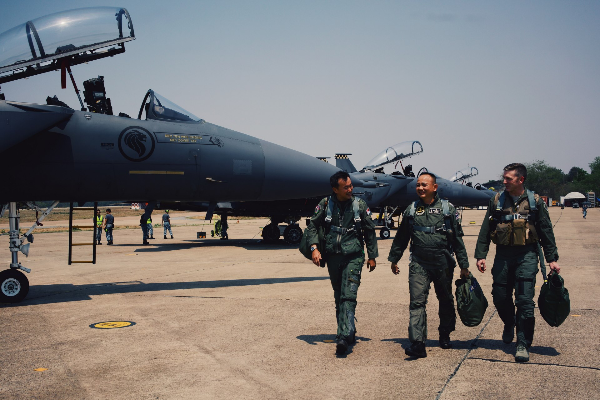 Exercise Directors for Exercise Cope Tiger Colonel (COL) Teo Soo Yeow, RSAF (left), Group Captain Wachirapon Muangnoi, RTAF (middle), and COL Shannon D. Smith