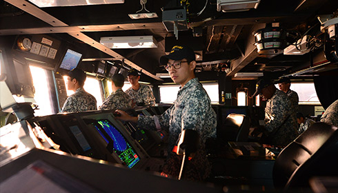 Navigating a naval vessel from the bridge of a ship, Republic of Singapore Navy